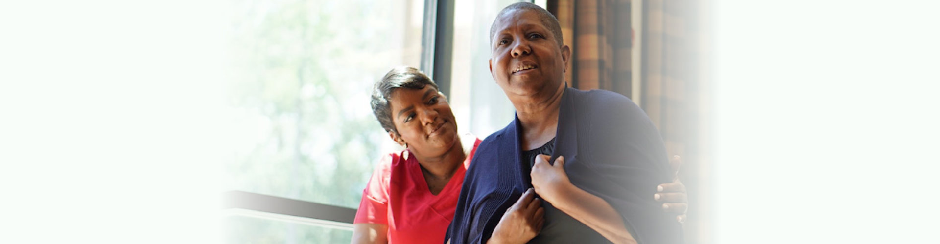 caring caregiver with senior woman